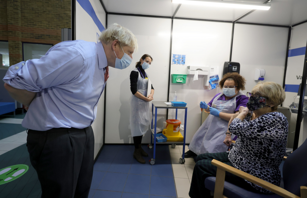 Lyn Wheeler meets UK Prime Minister Boris Johnson after becoming the first person in south east London to get a COVID vaccine.